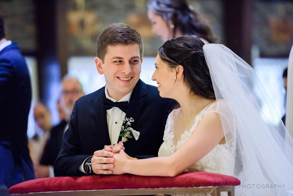Bride and Groom share a smile during ceremony.
