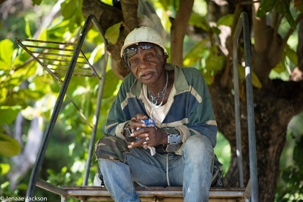 Old man takes a break from work under a tree in Ocho Rios, Jamaica.