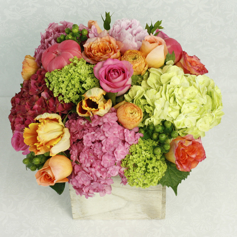 Uptown Blooms (Above) - full of bright and cheerful spring blooms in a whitewash wooden box