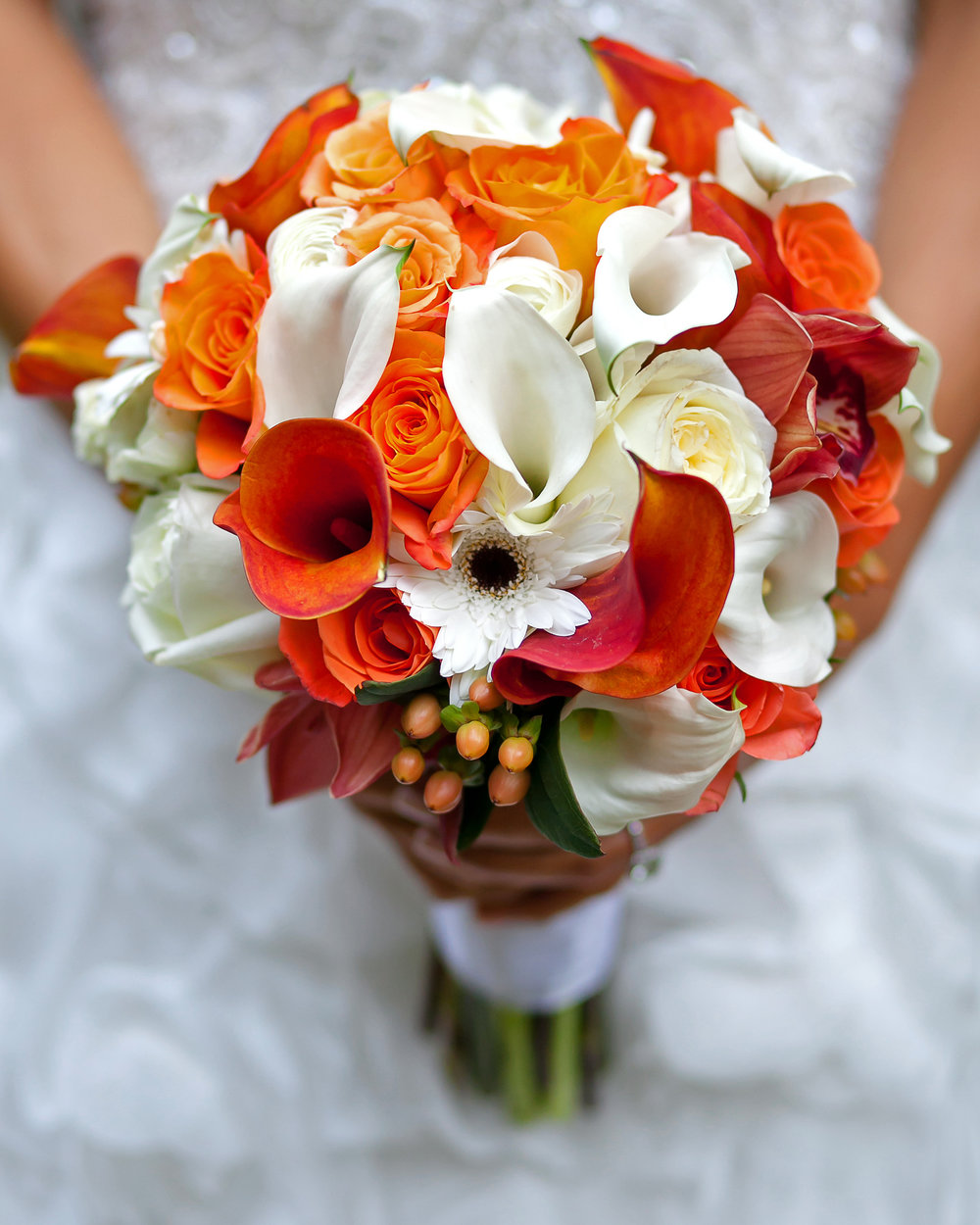 Orange Burst Nosegay (Above) - orange and white seasonal blooms in an elegant hand-tied bouquet