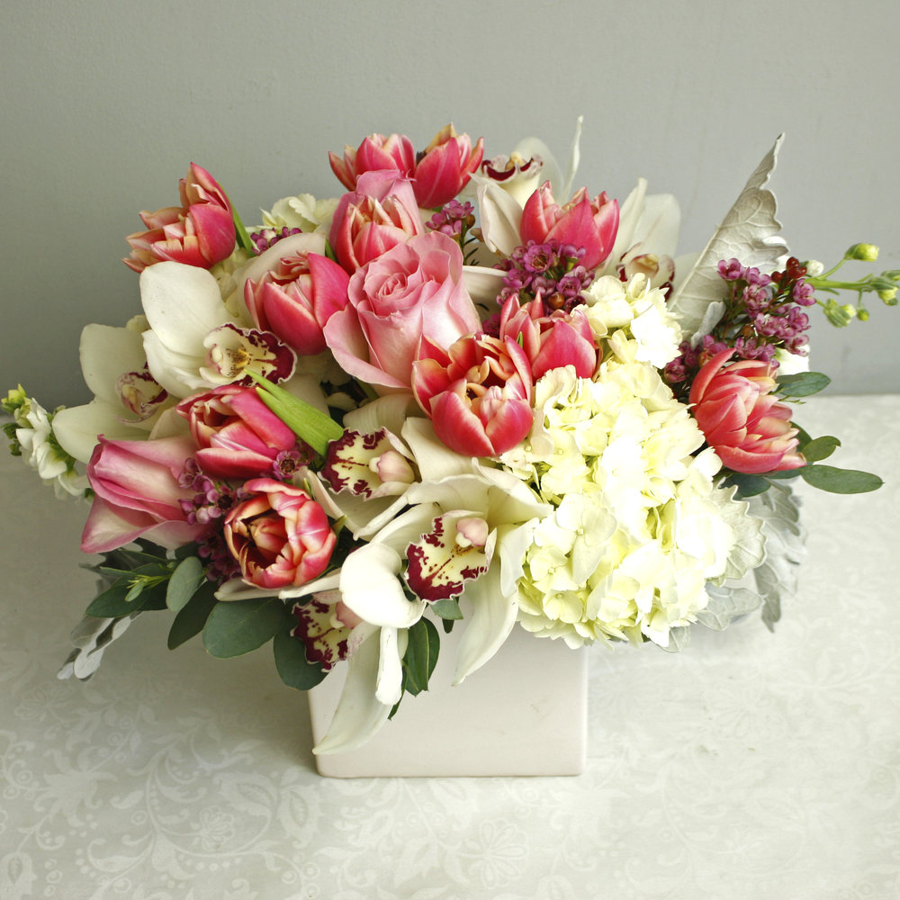 Je Ne Sais Quoi - a certain indescribably good quality about this arrangement makes it so great. Featuring Roses, Tulips, Hydrangea, Orchids, and more!
