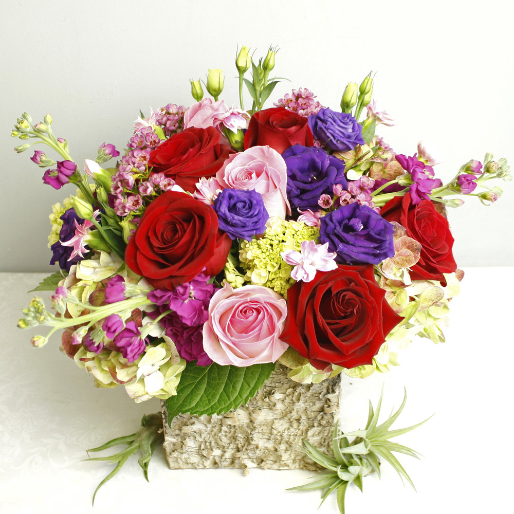 Coup De Foudre - vibrant and beautiful this is the perfect romantic gift for Valentine's Day. Featuring Roses, Lisianthus, Hydrangea, Stock, and more!