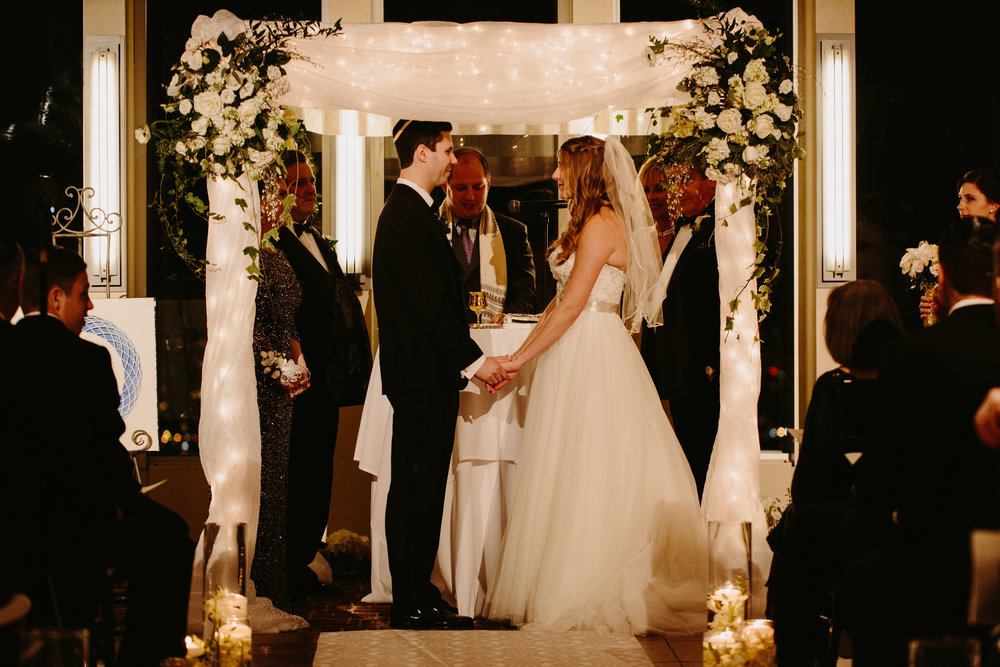 Chuppah - Fabric Pole Chuppah with Medium Flowers, String Lights Throughout, and Medium Fabric (1,350)