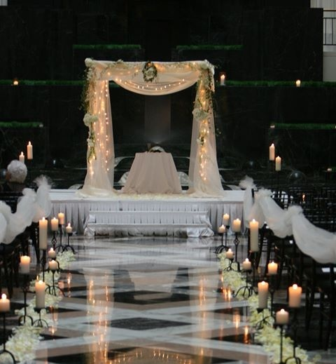 Chuppah - Fabric Pole Chuppah with Minimal Flowers, String Lights Throughout, and Substantial Fabric (1,300)