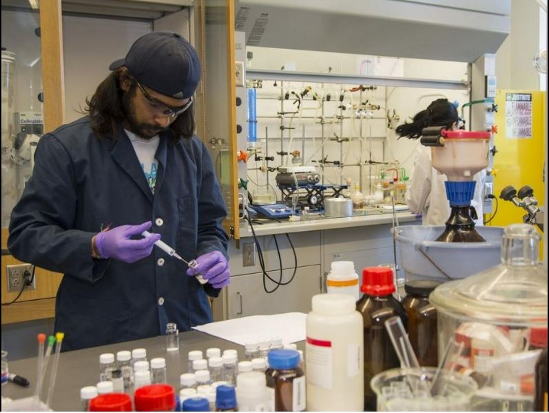 Ashvin Fernando, a Ph.D. candidate from Sri Lanka, works in one of the labs at the Richard E. Beaupre Center for Chemical and Forensic Sciences. - URI photo, Nora Lewis