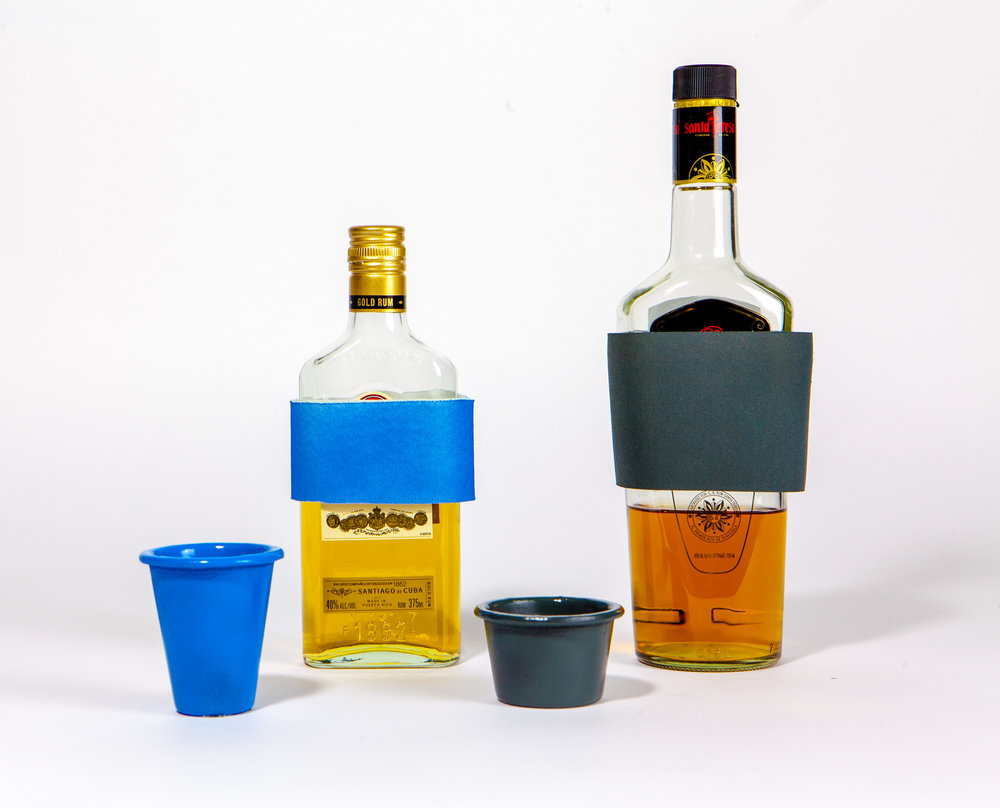 Mix By Color - Color coded measuring cups correspond to neoprene bottle wraps. A caretaker or loved one equips the bar with ingredients for the person with Alzheimer's favorite cocktail.