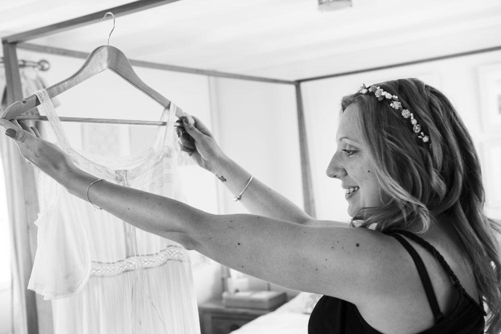 Bride admires her dress.jpg