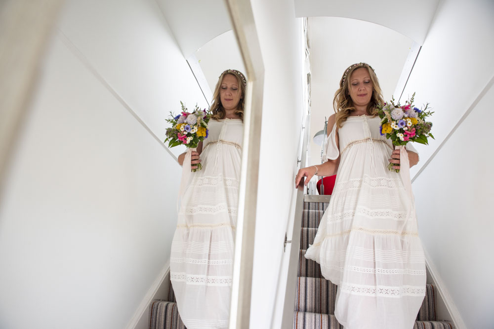 Bride descends stairs at Boho Cornwall.jpg