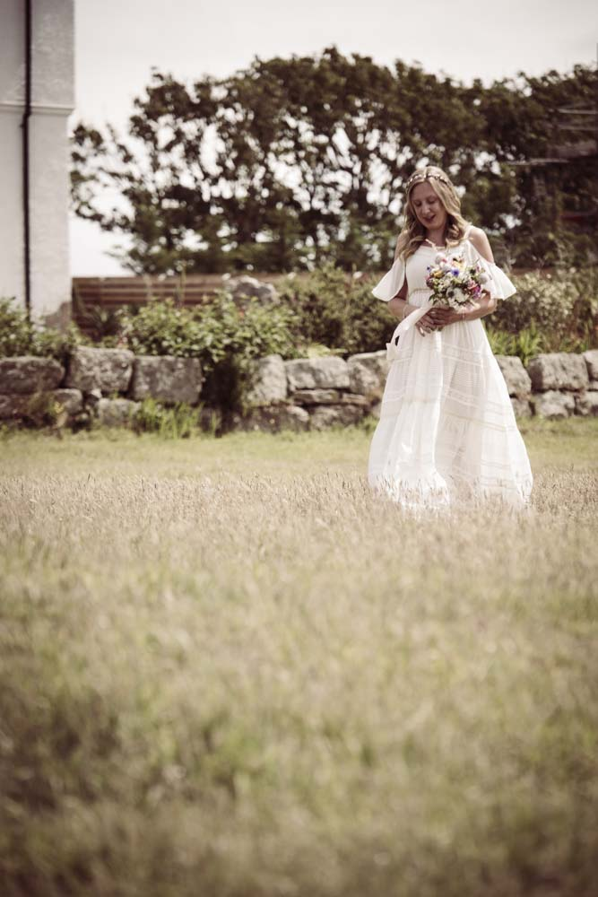 Bride crosses Lawn at Boho Cornwall.jpg