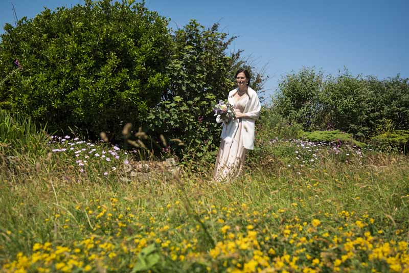 bride in cornisg flower meadow.jpg