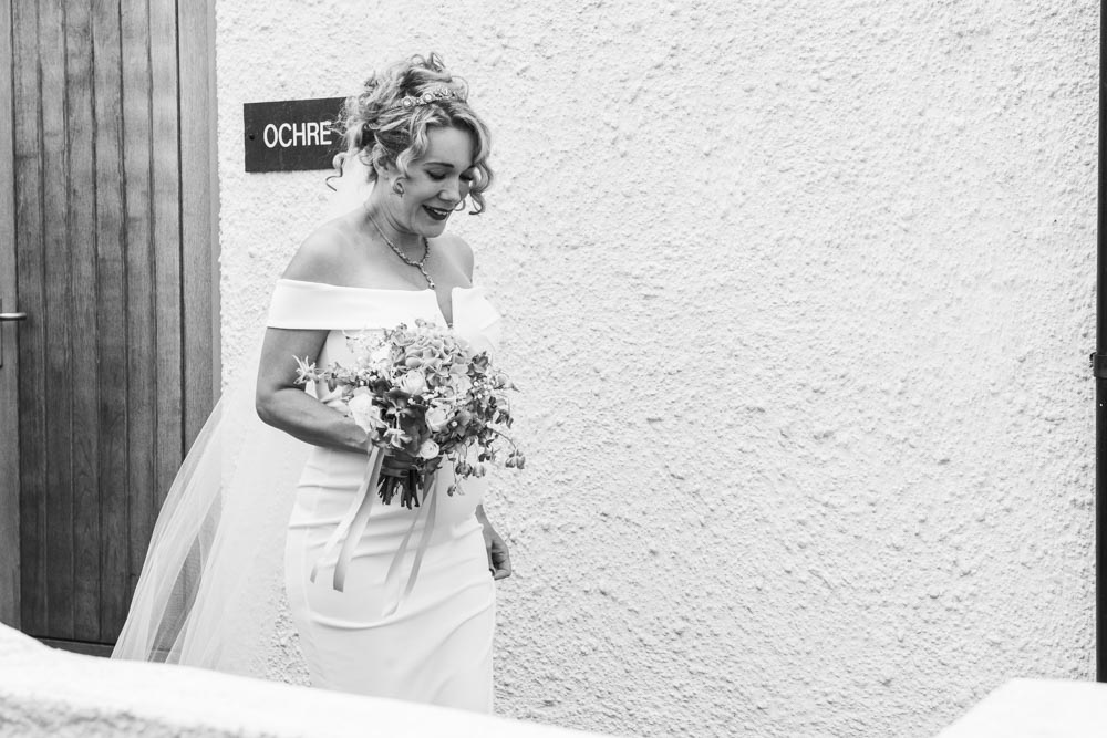 Bride leaves apartment at Boho Cornwall