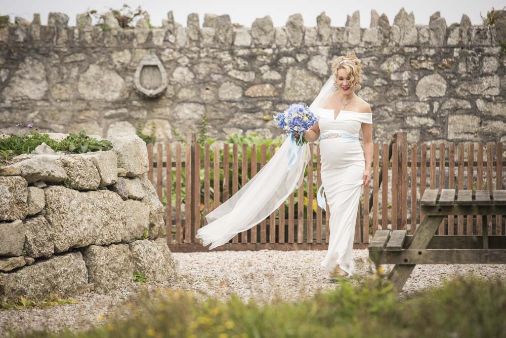 Bride walking down path Boho Cornwall
