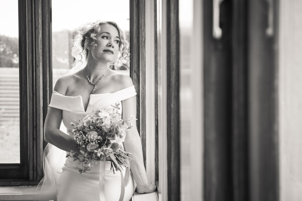 beautiful bride by window boho cornwall.jpg