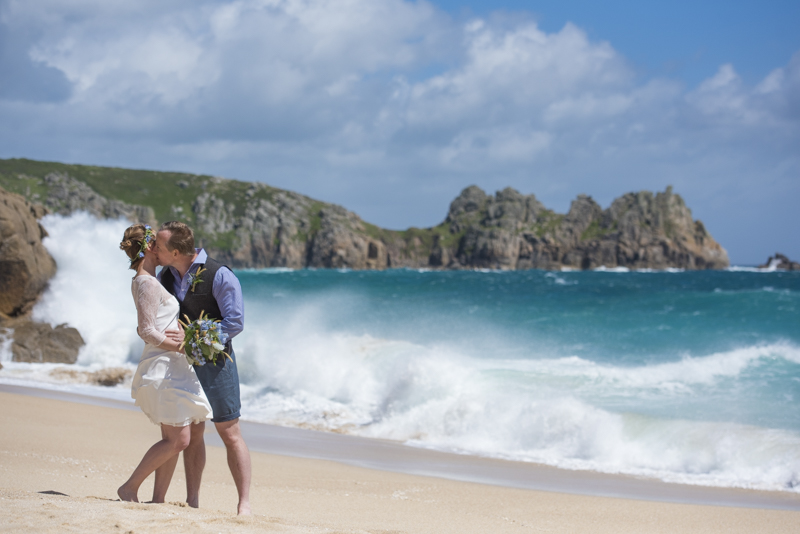 Porthcurno waves and wedding couple