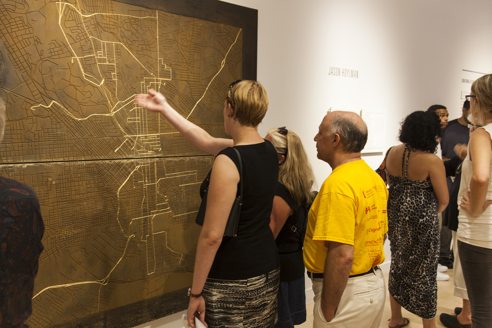 Visitors examining Hoylman's map of Station North and greater Baltimore.