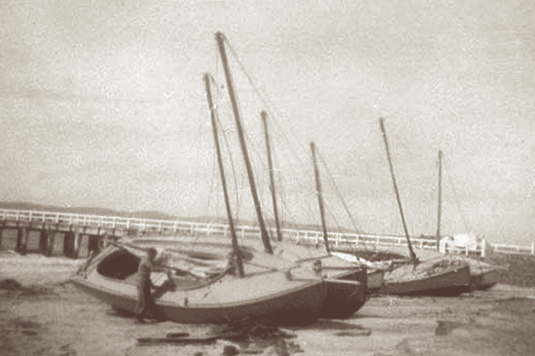 The Lacco's and other Queenscliff fishermen in the 1920's careened their coat boats along the shore of the Swan Spit beach. The boats were dragged ashore on greased rollers using a block and tackle, chocked on each with timber then anti fouled and painted.