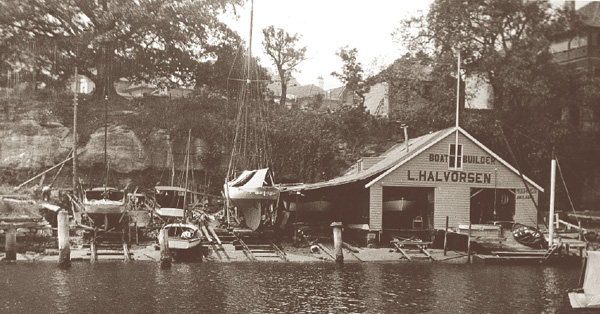 Halvorsen boat yard and slip at Neutral Bay in the 1930's, displaying a mixture of cruisers and yachts in various phases of building and repair.