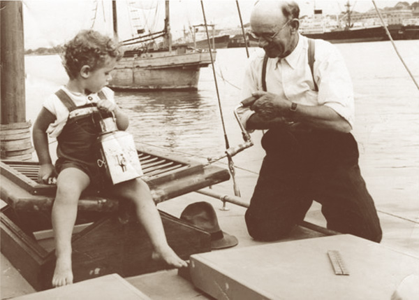 Norman R Wright, in 1950, ably assisted by young Mervyn James Hazell aboard Sirius ll, before the Sydney Gladstone Yacht Race.