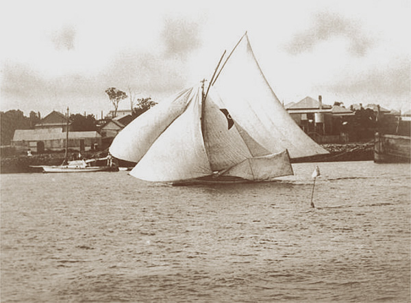 The Thomas, Davis and Porter, 22 ft skiff Gladys. Designed, built and skippered by Norman R Wright in 1907. Crew member Gladys Thomas, later became Norman's wife. This great performing classic wooden skiff, was built in a chook pen at the back of Gladys's home in Wordsworth Street Bulimba.