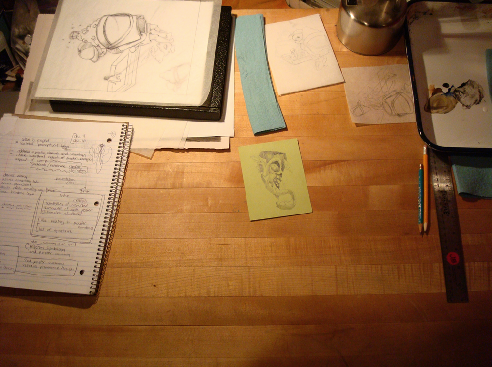 Like the warm light and wooden desk with stuff around it. shows what the person does at this desk. Can show sketches in this kind of environment.