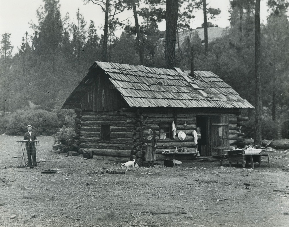 Mr. Dallas (at left) and his cabin in the creek bed just below the Benitoite Mine. The mine is behind the photograph, uphill. Photo by Ralph W. Dietz, ca. 193x, from John Sinkankas, Collection of Bill Larson. Click to enlarge.