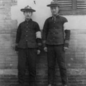 Two Imperial University students wearing white arm bands on left arm of military uniform; mourning death of the Empress Dowager, 1908?, Peking. San Diego County producers of pink tourmaline had much to mourn as well. (Library of Congress)