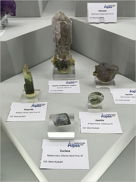 More Alpine views  Also from the Alps exhibition, a variety of specimens from Tirol and Salzburg, Austria. Like an antique telephone pole insulator, the amethyst scepter at center displays only a hint of purple. (Photo: Will Larson)
