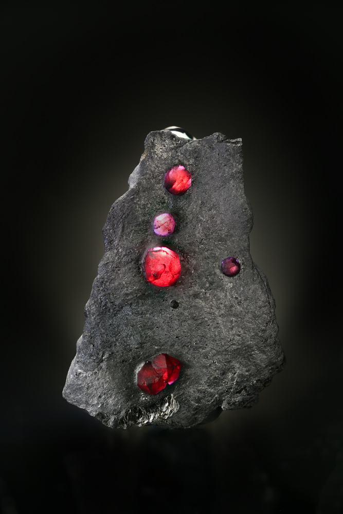 "Red embers.  A gorgeous example of pyrope garnets in schist, from the Red Embers Mine in Erving, Massachusetts. Read the story behind this specimen at the tail end of "" Appraising Harvard Redux ."" (Photo: Ben DeCamp)"
