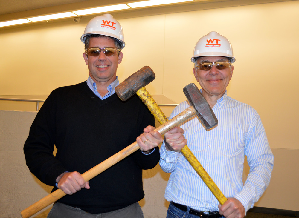Peabody Director David Skelly and David Friend prepare to strike the first blows in the demolition phase of construction. (Photo: Sally Pallatto)