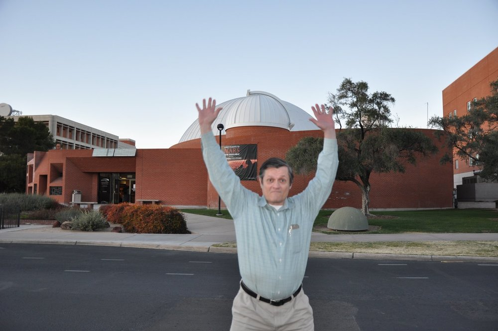 Jim Spann as Atlas, holding up the sky, on his way to the reception in the planetarium building for American Mineral Heritage: The Harvard Collection (see more about this above). (Photo: Gail Copus Spann)