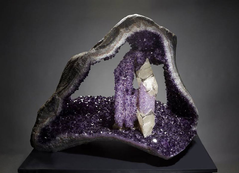 A deep purple amethyst geode from Uruguay standing about 3 feet high. It is from the collection of David Friend. The dramatic white calcite crystal, almost 2 feet long, is covered with sparkly quartz crystals. A gorgeous and unusual geode. (Photo courtesy Yale University)