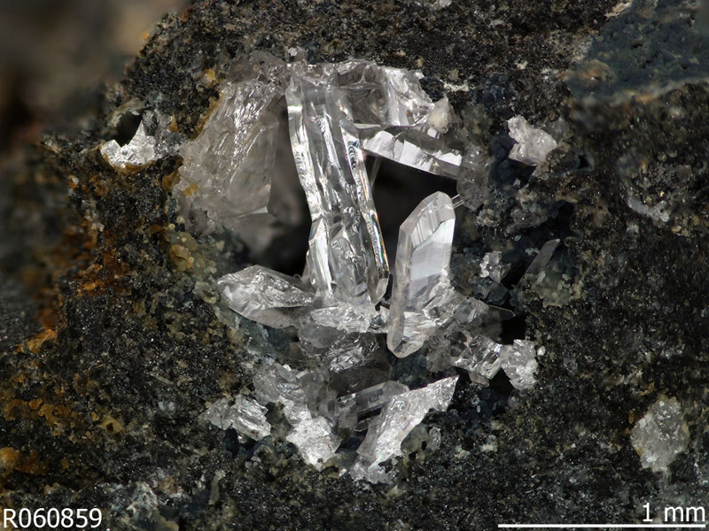 A case in point.  Shown here are colorless fiedlerite crystals, the byproduct of lead mining in Lavrio, Greece in classical times. Slag from the mining was dumped into the Mirtoan Sea and over the years reacted with the water to form minerals like this one, found only in particular slag localities. (Photo:  RRUFF )