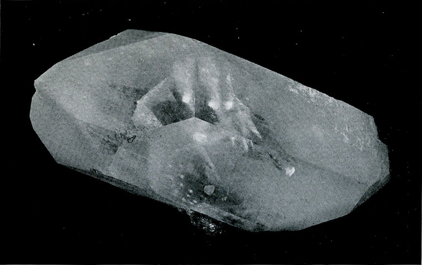 "Quartz from California. A ""phantom"" showing one quartz crystal deposited around one previously formed."