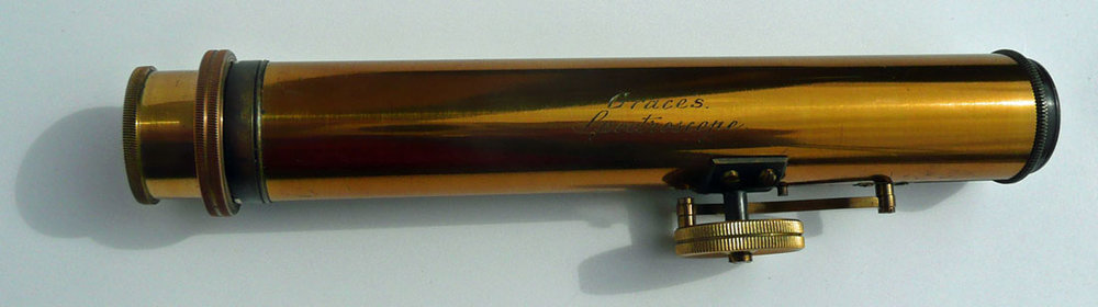 """Grace's Spectroscope."" We like the nifty external watch-spring mechanism on this large (15 cm) straight-hand spectroscope by John Browning, London. It is made of Zapon-lacquered and -blackened brass with an adjustable gap and 5 prisms. Two more views available. (Photo courtesy the Virtual Museum of the History of Mineralogy)"