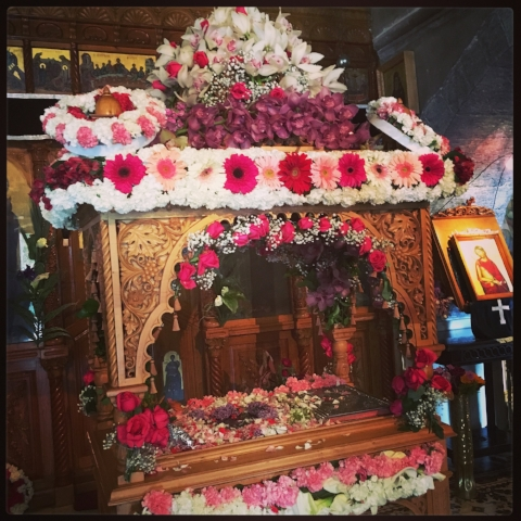 "Parishioners' adorn the ""coffin"" of Christ with flowers on Good Friday, then display them so worshipers can visit (and kiss) them"