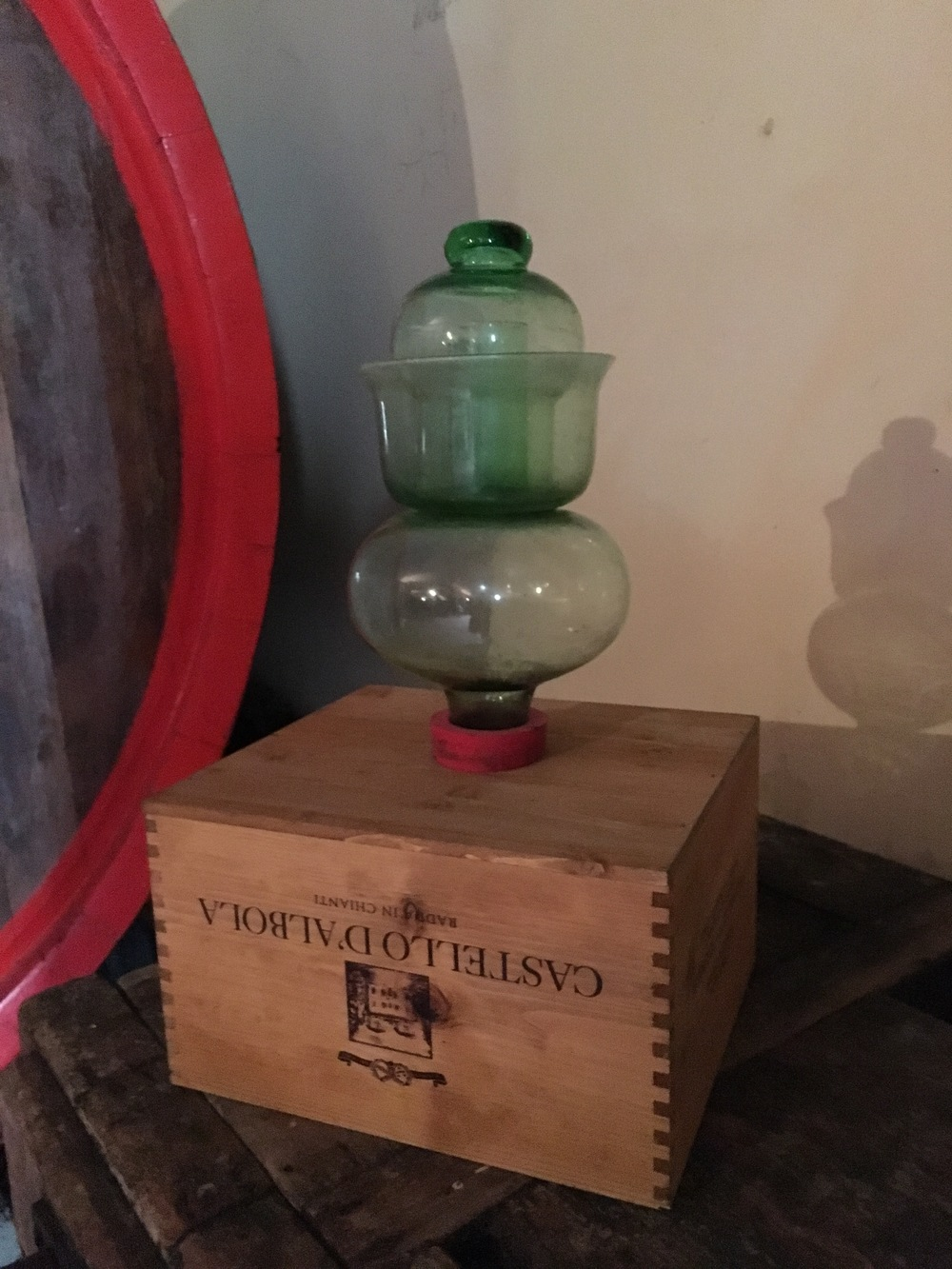 These glass bulbs are on the tops of all the barrels to indicate if the barrel is full. It allows for more wine to be aded as needed, without allowing much air in which would oxidize the wine, negatively impacting color and flavor. Invented by Leonardo DaVinci!