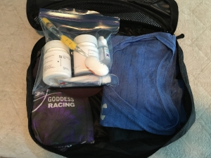2 shirts, underwear, socks, a hat, gaiter that can be used as a face towel/headband/kerchief/etc, meds, toothbrush/paste