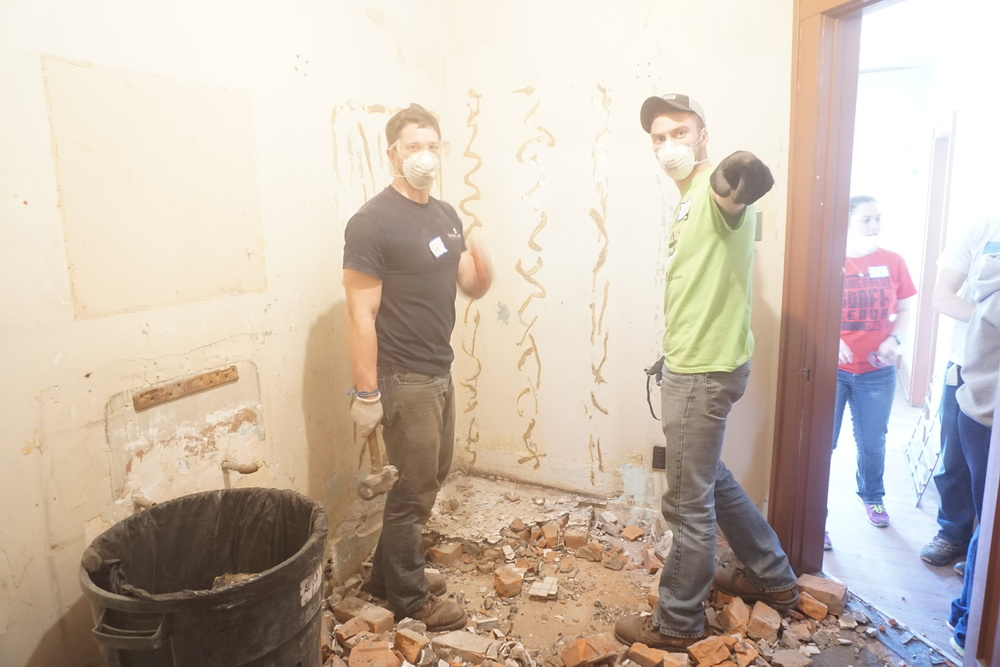 ripping up shower bricks 2.JPG