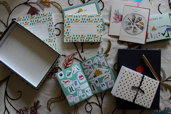 "(Clock-wise from left:  Leopard Desk Set  (including a funny little  stickerbook  at 6 o'clock; a variety of greeting cards for upcoming holidays and ""just because"" occasions; and the  pièce de résistance , the gorgeous  Heritage Writing Kit  in ""Tulum"", especially appropriate as that is where I proposed to Nolan.)"