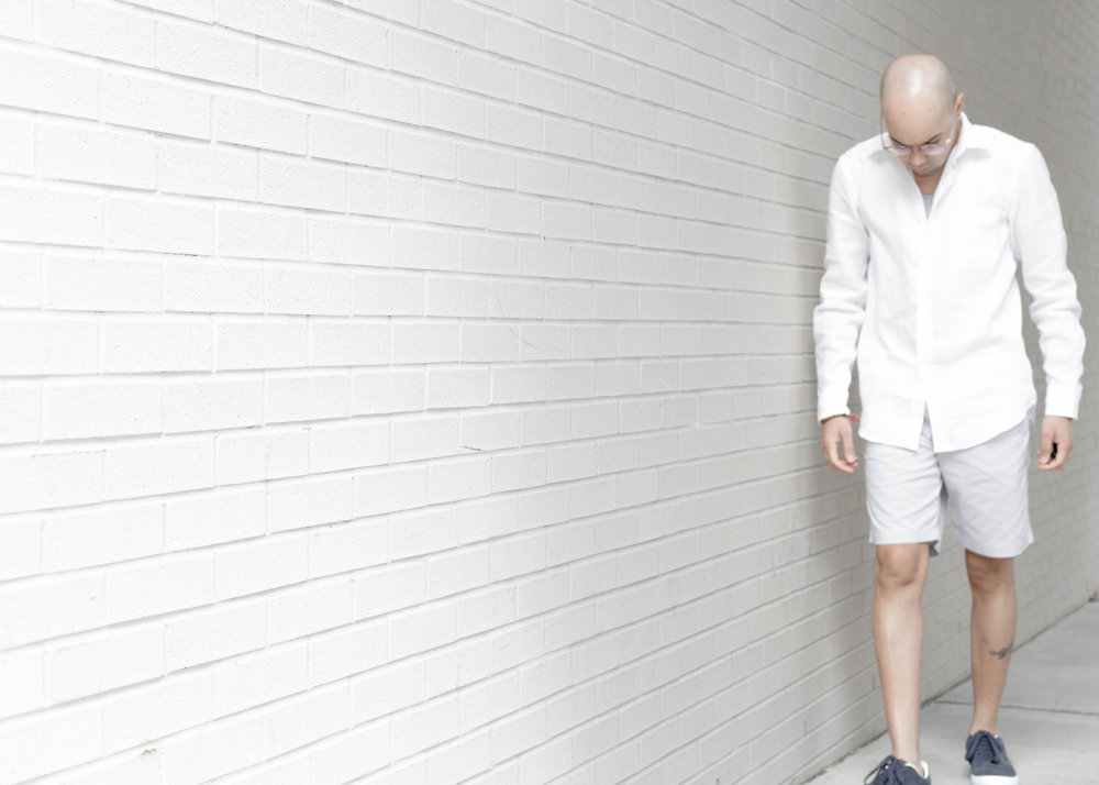 how-to-wear-stripes-this-spring-stripe-shorts-solid-shirt-walk.jpg