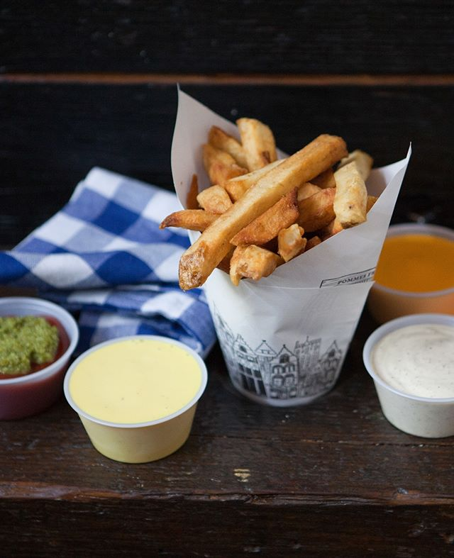 Stacked and ready. Sauce galore at Pommes Frites. #belgianfries #papercones #littlebeastnyc