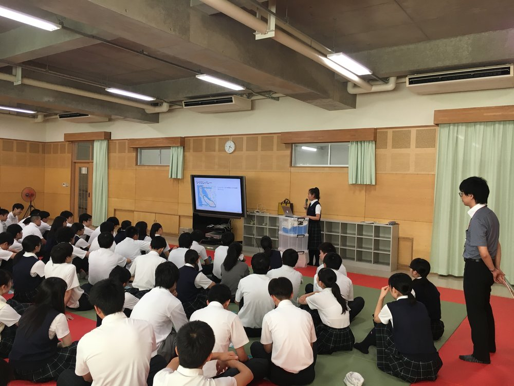 Sakurako Nyudo presenting on the US-Japan relationship at her high school.