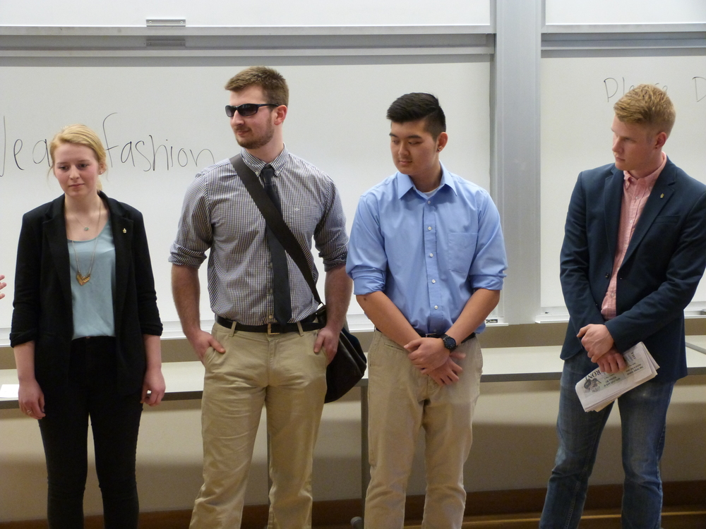 Kristen, Sam, Minh, and Brendan in business casual dress.