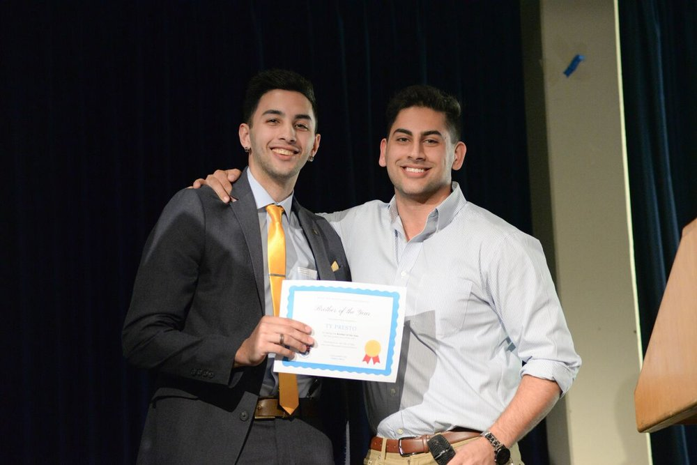 Brother Khademi presenting Brother Presto with Brother of the Year