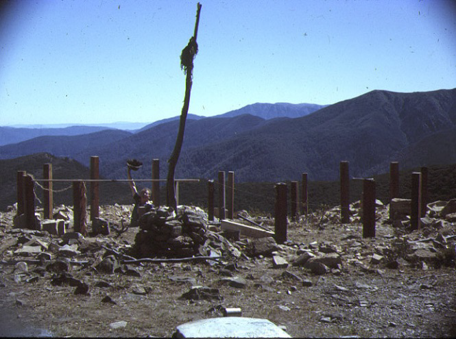 Footings happening. Most of the timber posts, the kitchen sink, the water tanks, the aluminium framing and sheets were carried in by hand from the end of the 4WD track along the North razorback. The route contoured around the NW side of Feathertop coming out near the spring. The floor bearers and joists were built by 2 or 3 people whilst some 20 others made at least two trips each for another load.