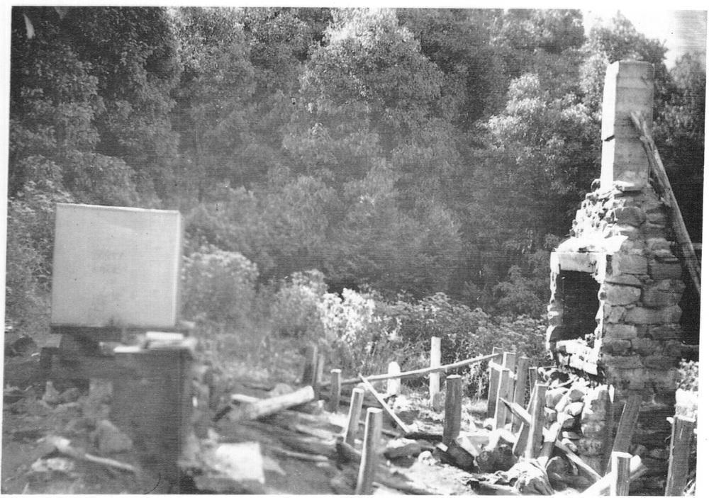 Scene after the cabin was moved to Buller. The tank has since rolled to below the chimney