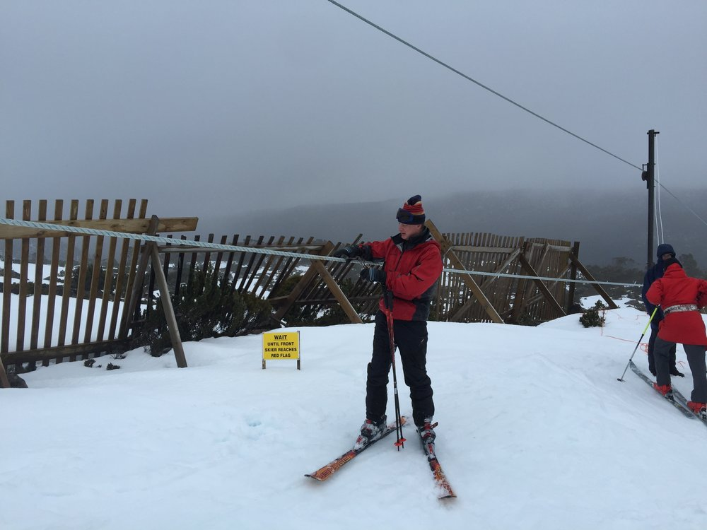 Attaching a nutcracker to the tow rope can be awkward if the rope is higher than usual. The author at the University Tow, Mt Mawson, Tasmania in August 2016.