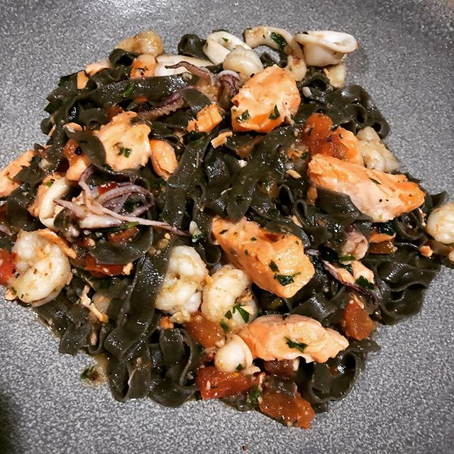 Pasta special: Squid Ink Pasta with #calamari #rockshrimp #salmon in garlic white #wine with #tomatoes