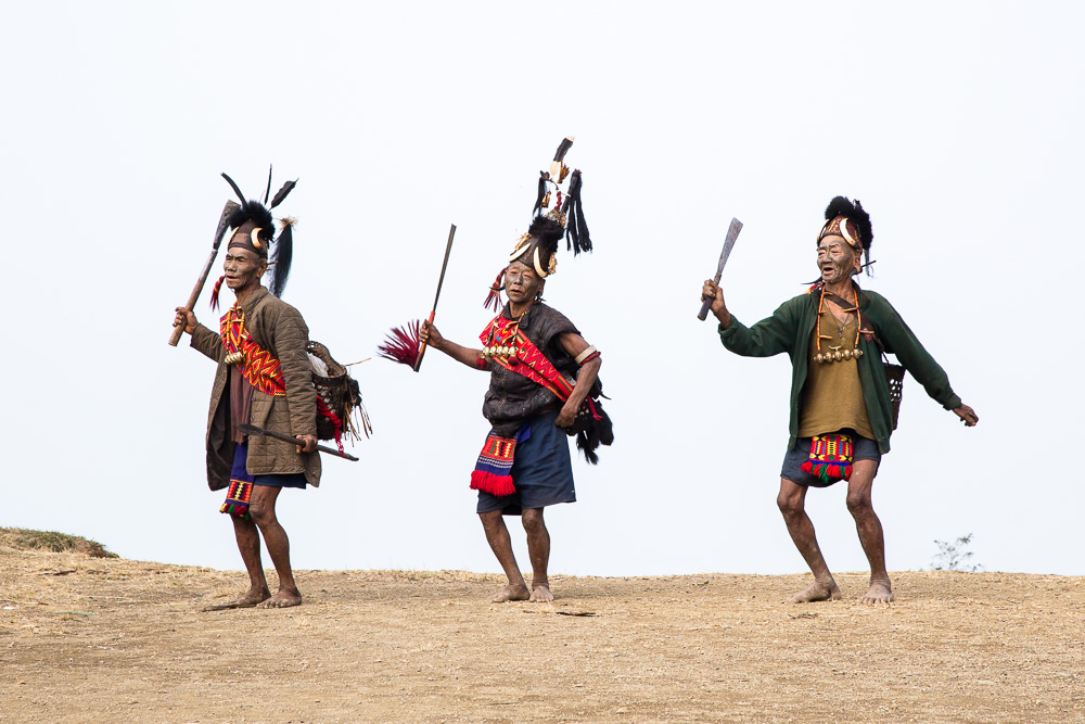 Headhunters performing old tribal dance, Longwa Village, Nagaland, on the border with Myanmar
