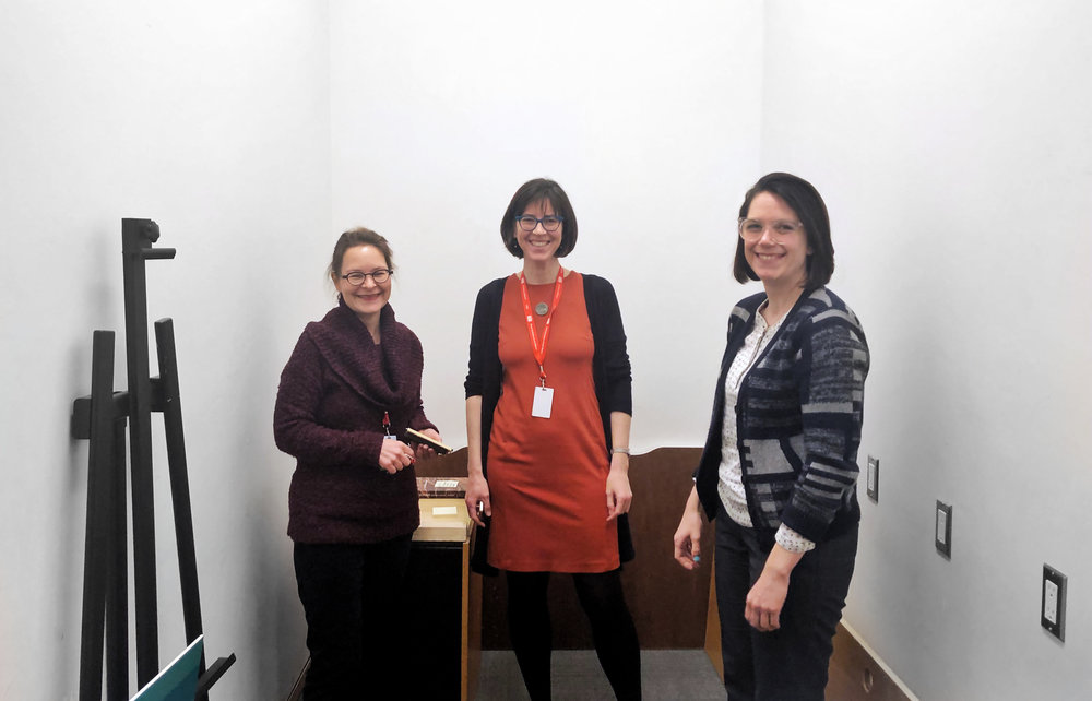 ART GALLERY OF ONTARIO'S CHIEF CONSERVATOR MARIA SULLIVAN (LEFT), AND HEAD OF LIBRARY & ARCHIVES AMY FURNESS (CENTER), AND SMALL DATA INDUSTRIES' ERIN BARSAN (RIGHT) IN THE FUTURE HOME OF AGO'S TIME-BASED MEDIA LAB.